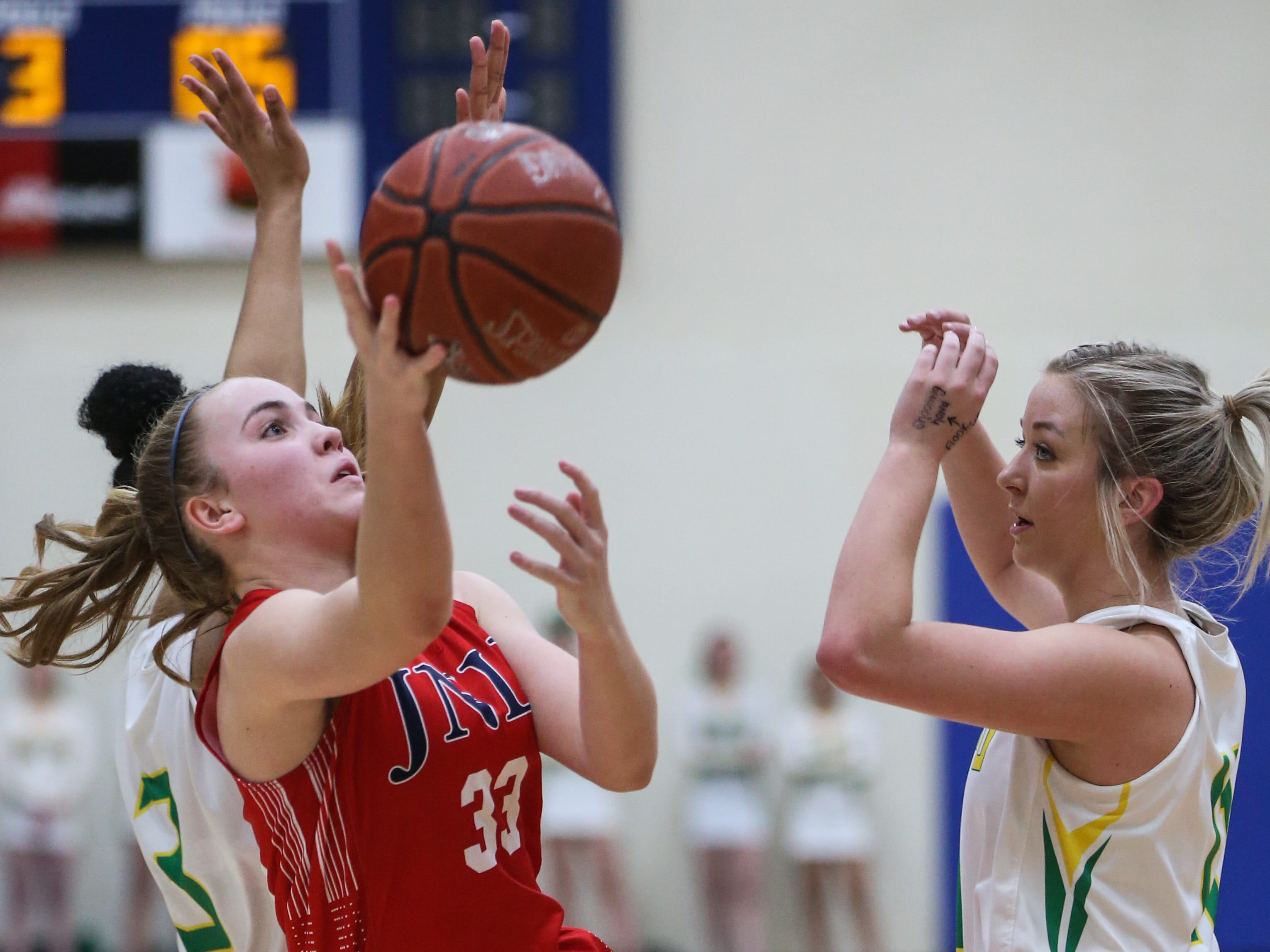 Jim Ned's Brooke Galvin tries to shoot past Idalou during the I-3A regional tournament Friday, Feb. 22, 2019, at Wayland Baptist University in Plainview.