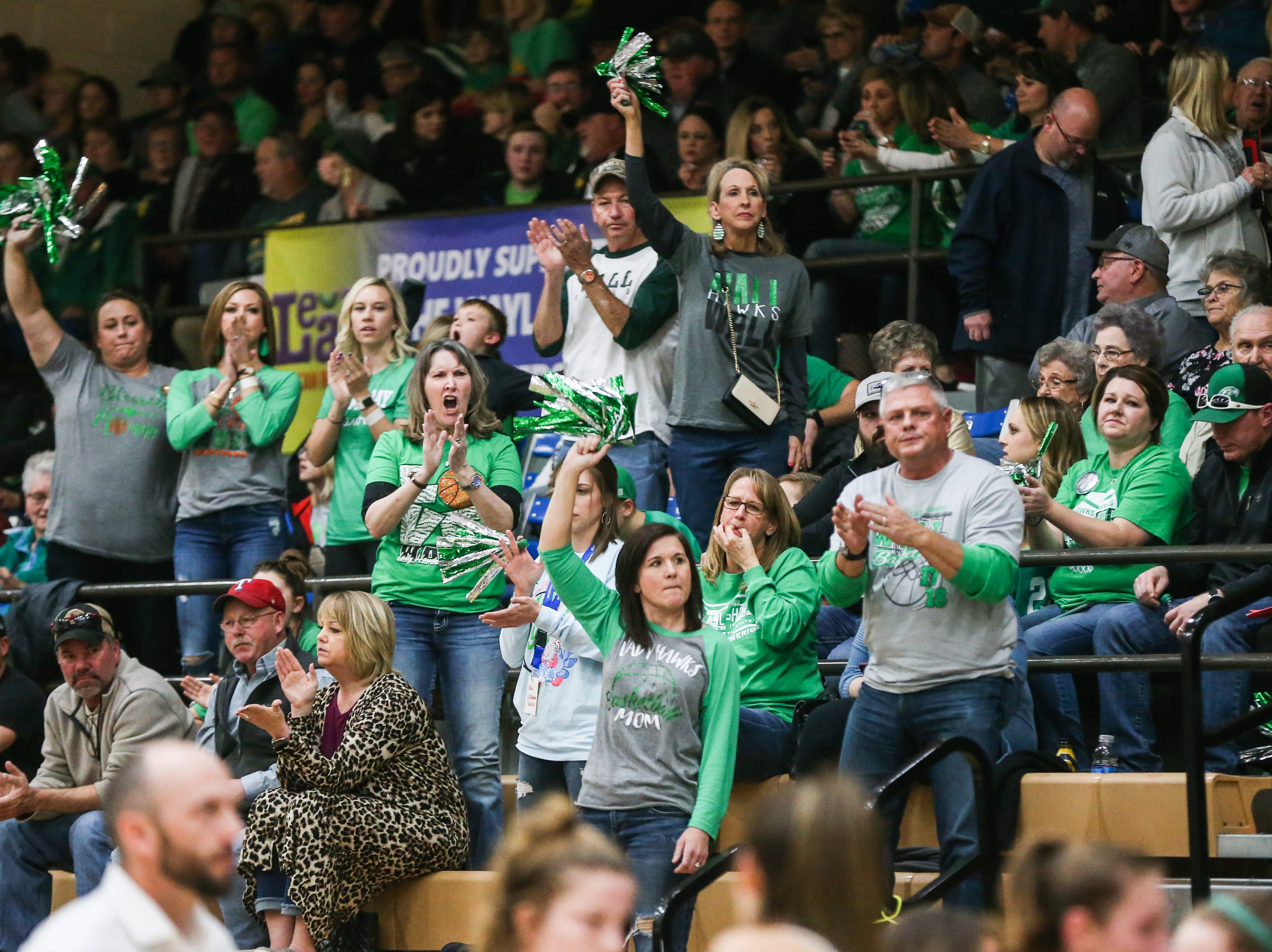 Wall fans cheer on their team during the 1-3A regional tournament against Brock Friday, Feb. 22, 2019, at Wayland Baptist University in Plainview.