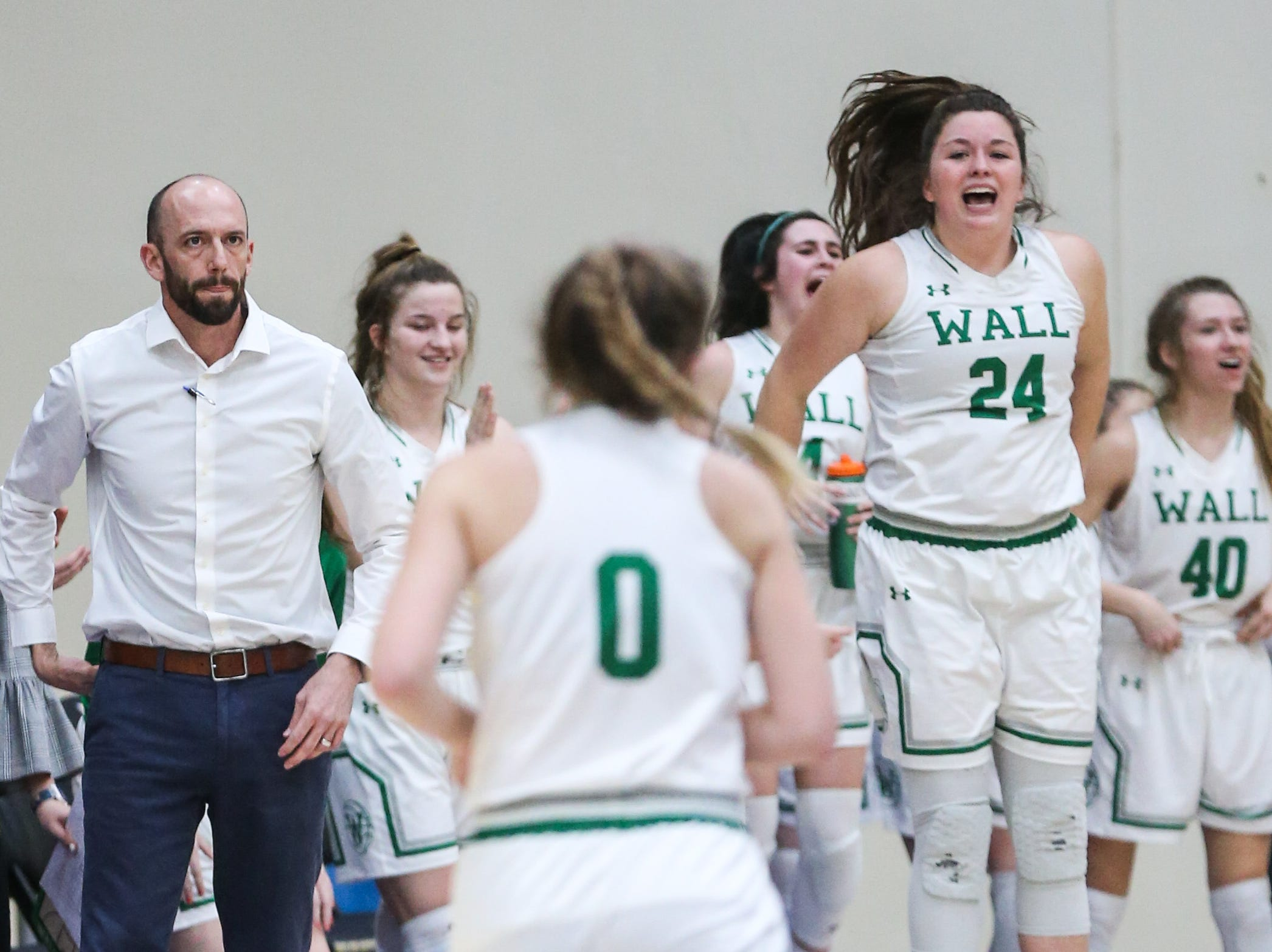 Wall players at half time during the 1-3A regional tournament against Brock Friday, Feb. 22, 2019, at Wayland Baptist University in Plainview.