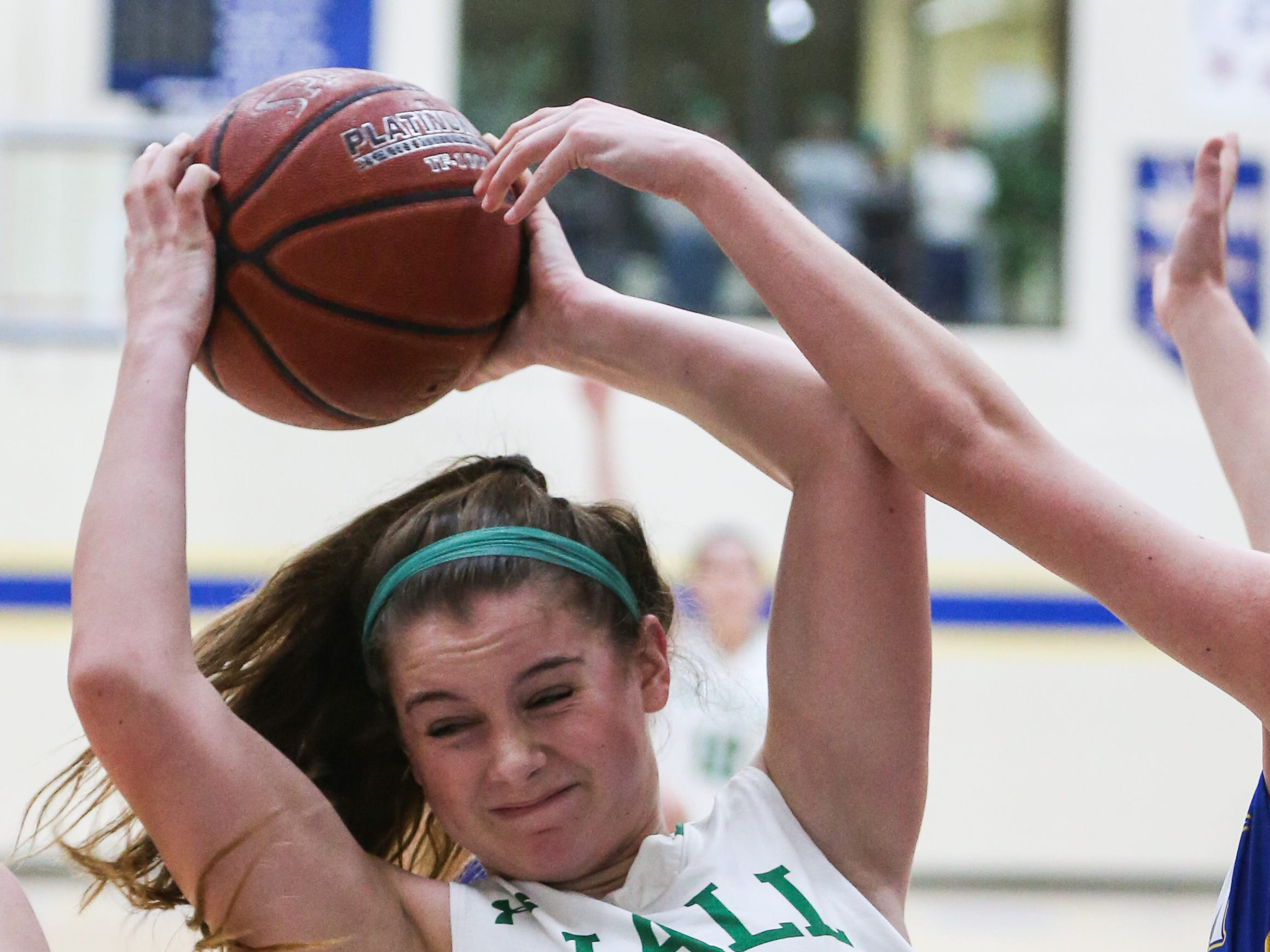 Wall's Kylie Phillips fights for the rebound with Brock during the I-3A regional tournament Friday, Feb. 22, 2019, at Wayland Baptist University in Plainview.