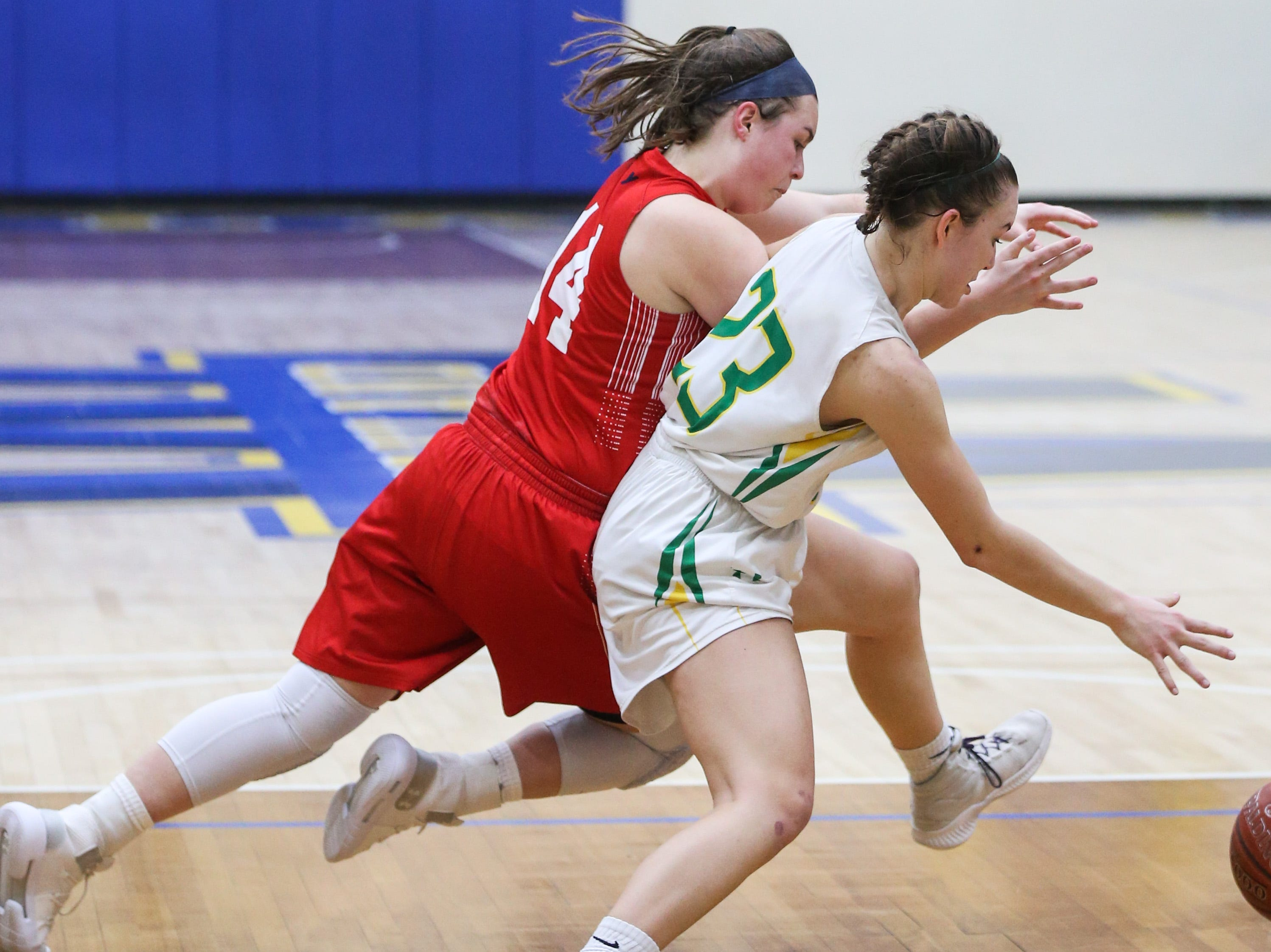 Jim Ned's Jenna Moore and Idalou's Shaylee Stovall fight for possession of the ball during the I-3A regional tournament Friday, Feb. 22, 2019, at Wayland Baptist University in Plainview.