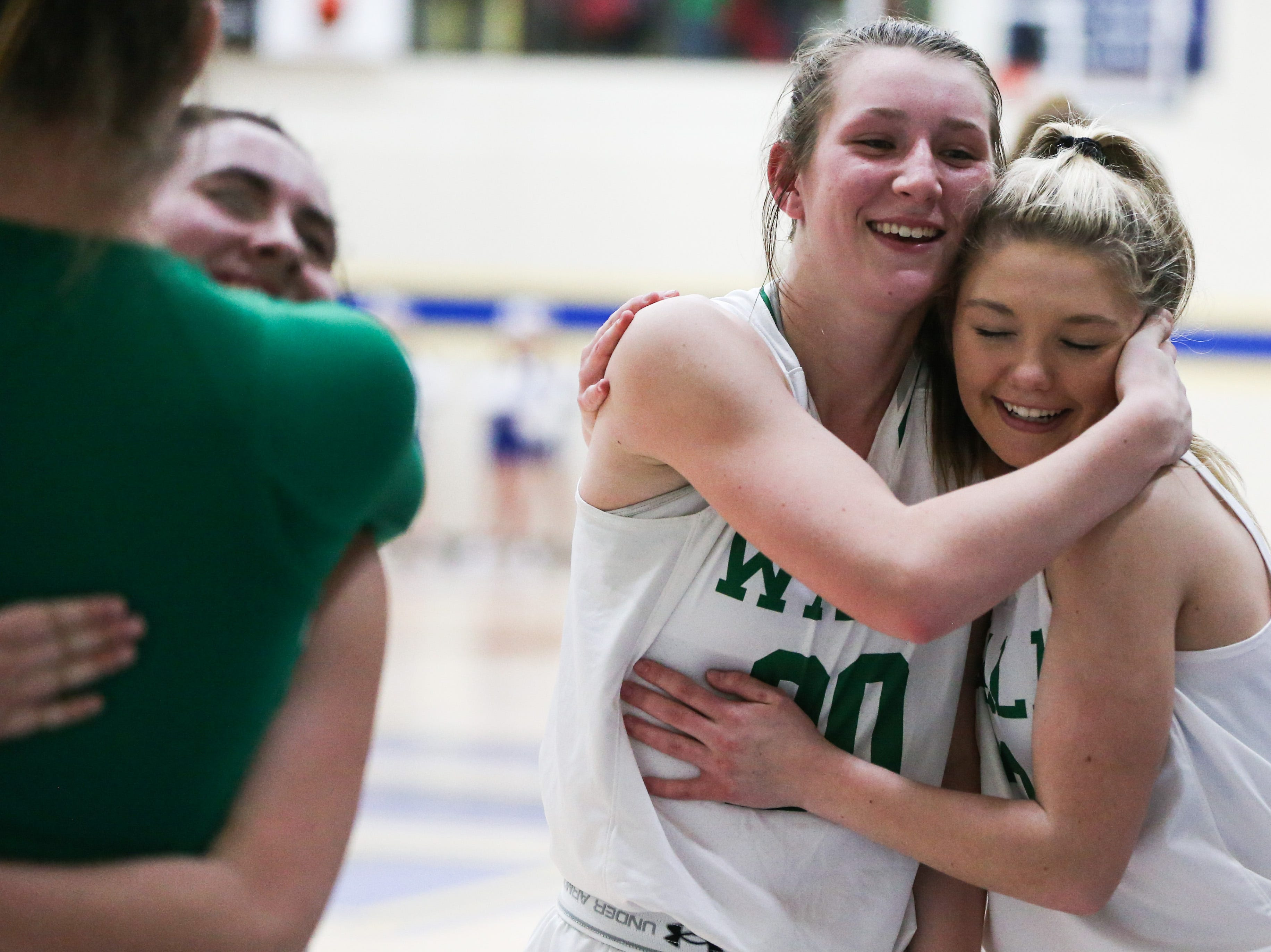 Wall girls celebrate their victory over Brock during the 1-3A regional tournament Friday, Feb. 22, 2019, at Wayland Baptist University in Plainview.