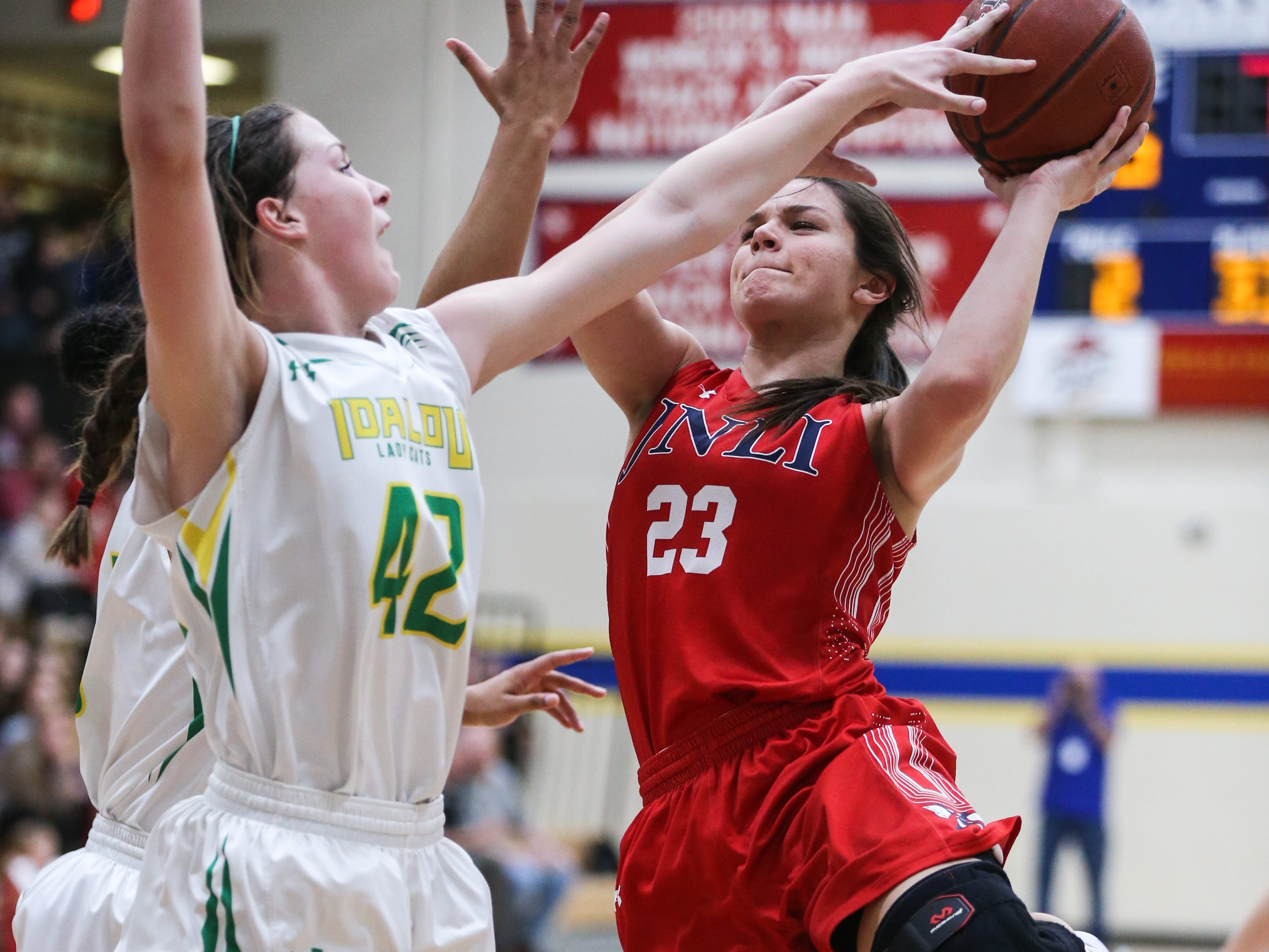 Jim Ned's Libby Tutt tries to shoot past Idalou's Taylor Houston during the I-3A regional tournament Friday, Feb. 22, 2019, at Wayland Baptist University in Plainview.