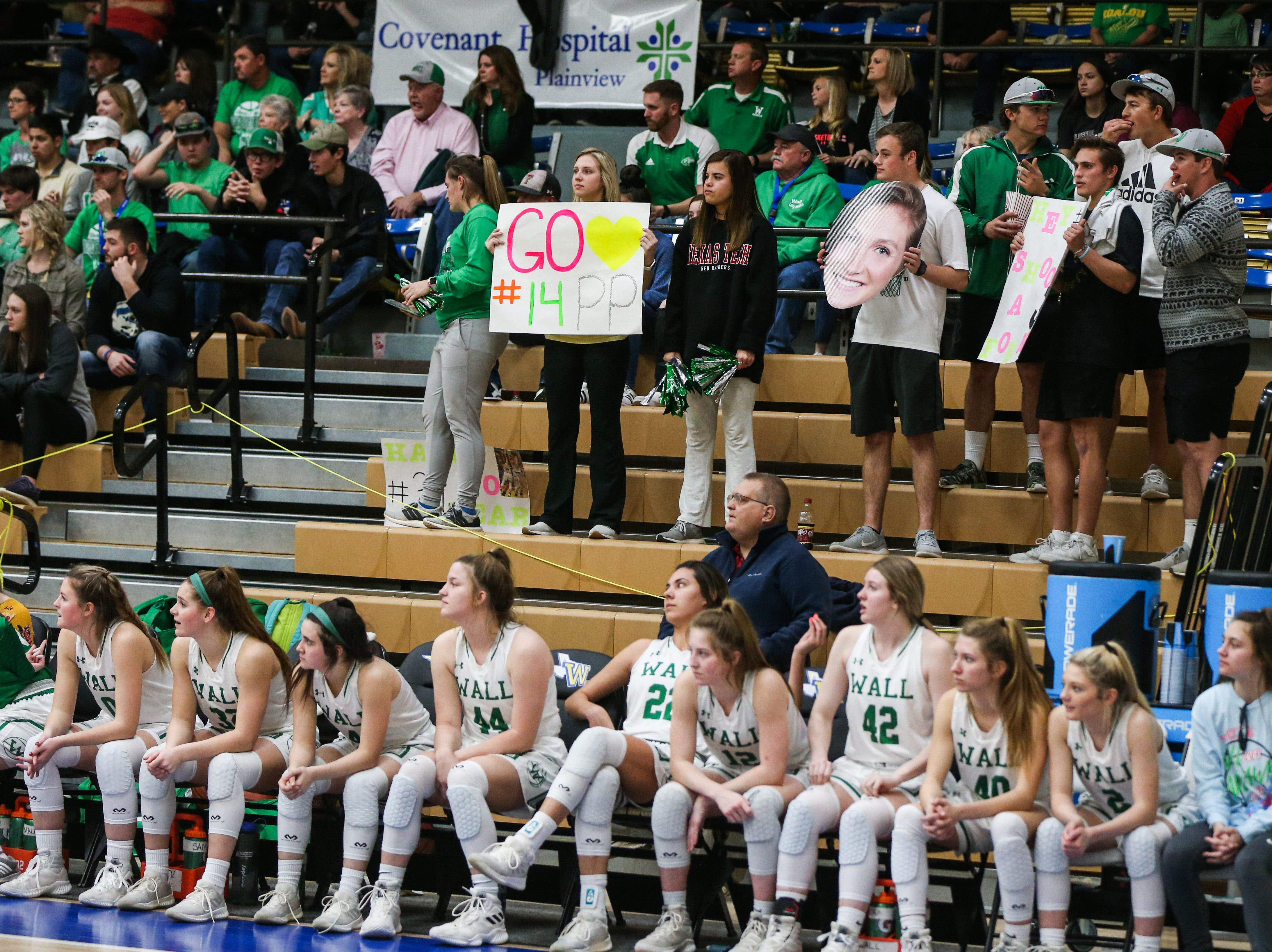 Wall fans hold up signs for their team during the 1-3A regional tournament against Brock Friday, Feb. 22, 2019, at Wayland Baptist University in Plainview.