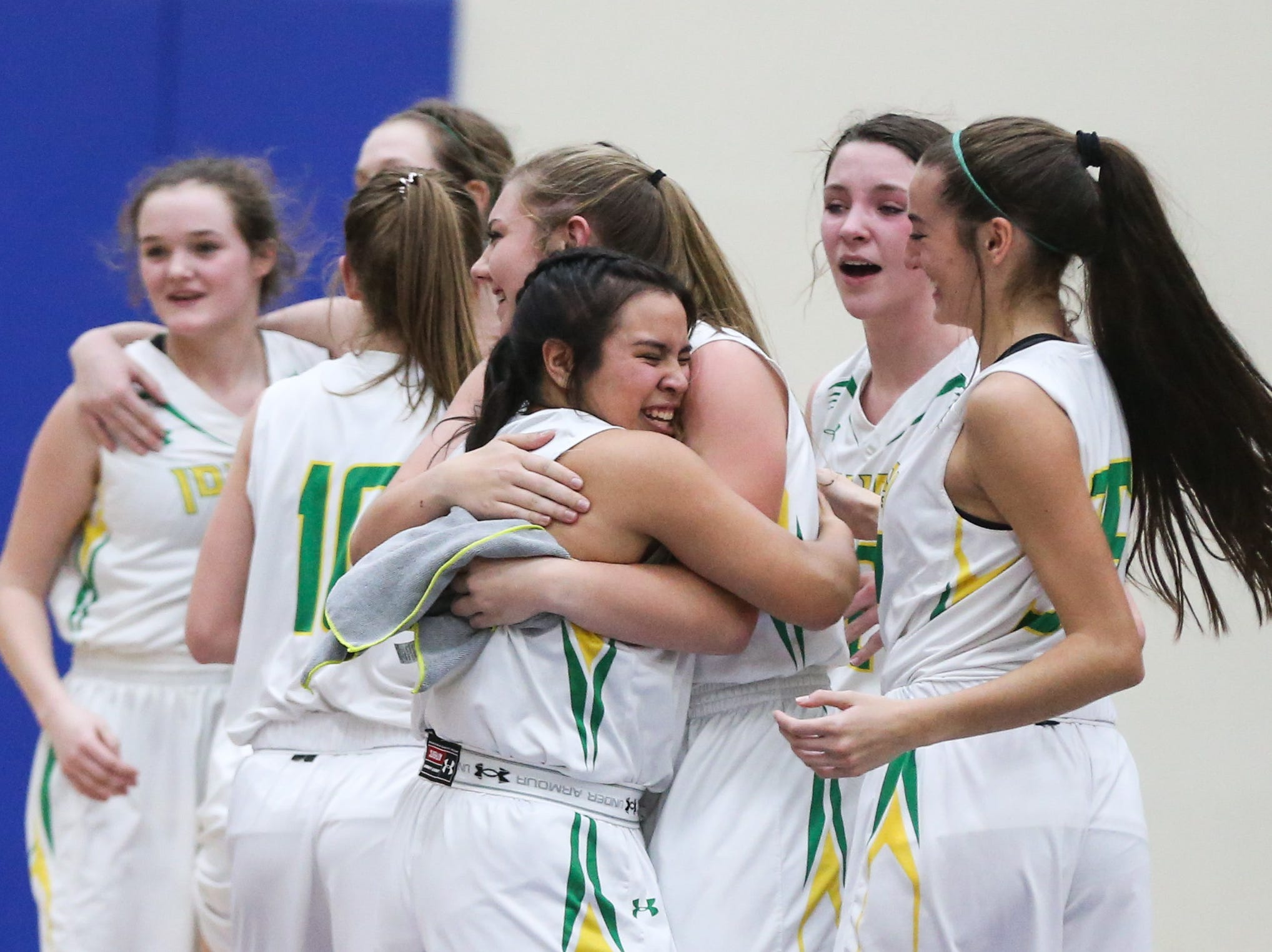 Idalou players celebrate their victory over Jim Ned during the I-3A regional tournament Friday, Feb. 22, 2019, at Wayland Baptist University in Plainview.