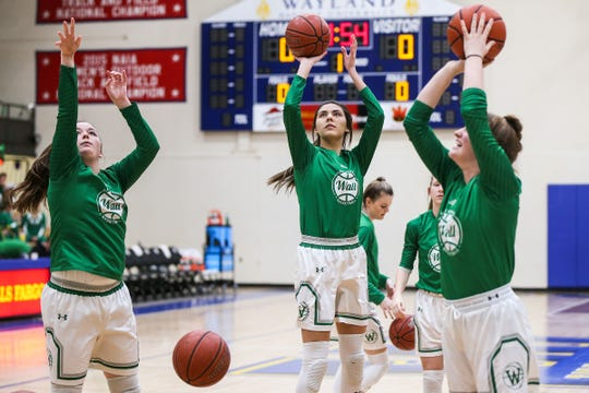 Wall girls warmup before the I-3A regional finals against Idalou Saturday, Feb. 23, 2019, at Wayland Baptist University in Plainview.