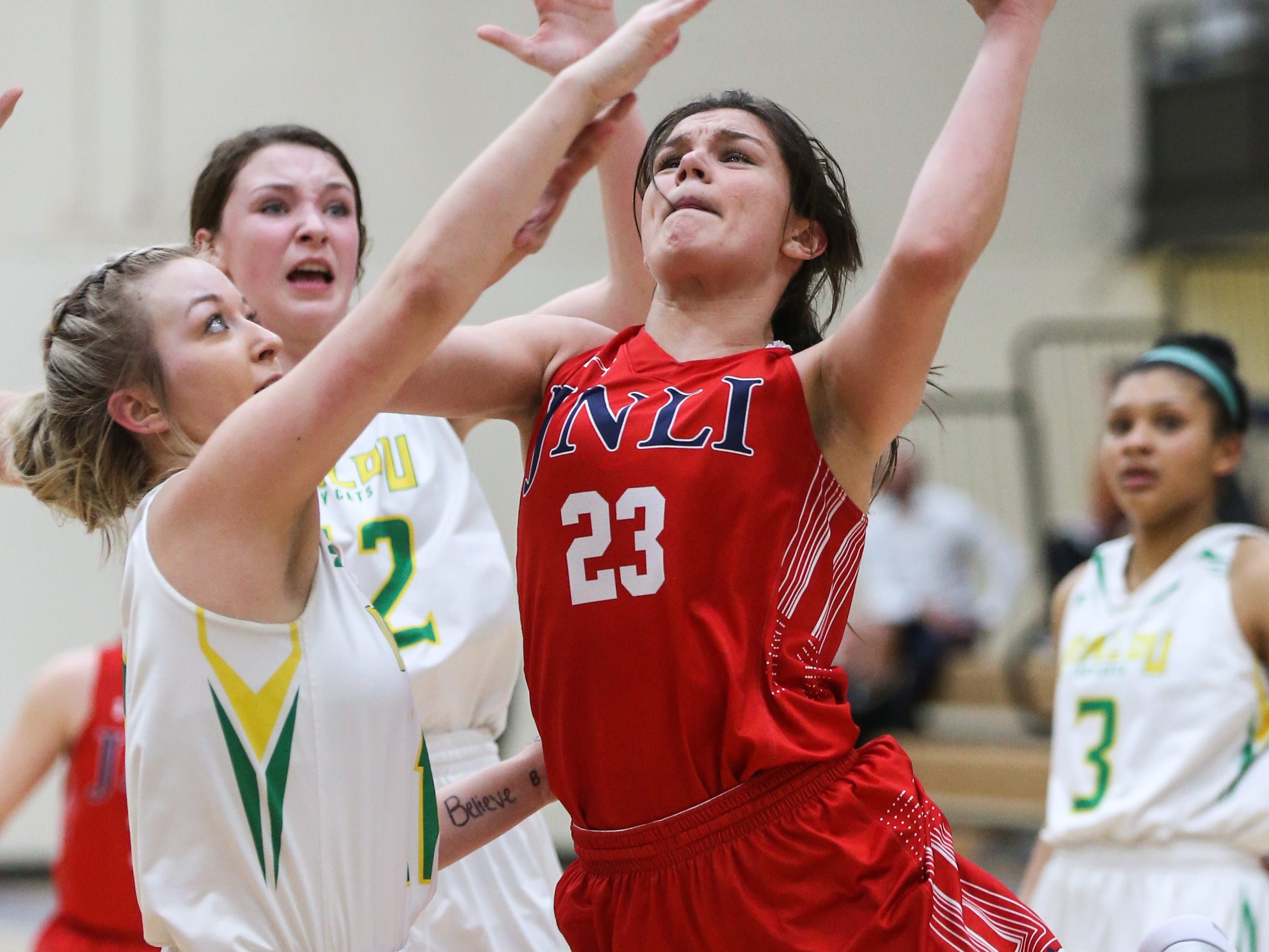 Jim Ned's Libby Tutt goes for a layup as Idalou players block during the I-3A regional tournament Friday, Feb. 22, 2019, at Wayland Baptist University in Plainview.