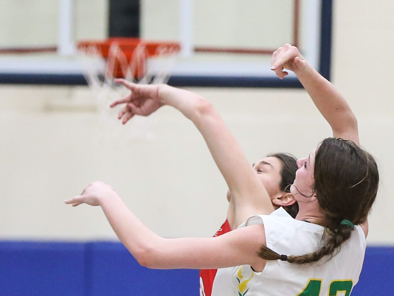 Idalou's Taylor Houston and Jim Ned player fight to reach for a pass first during the I-3A regional tournament Friday, Feb. 22, 2019, at Wayland Baptist University in Plainview.
