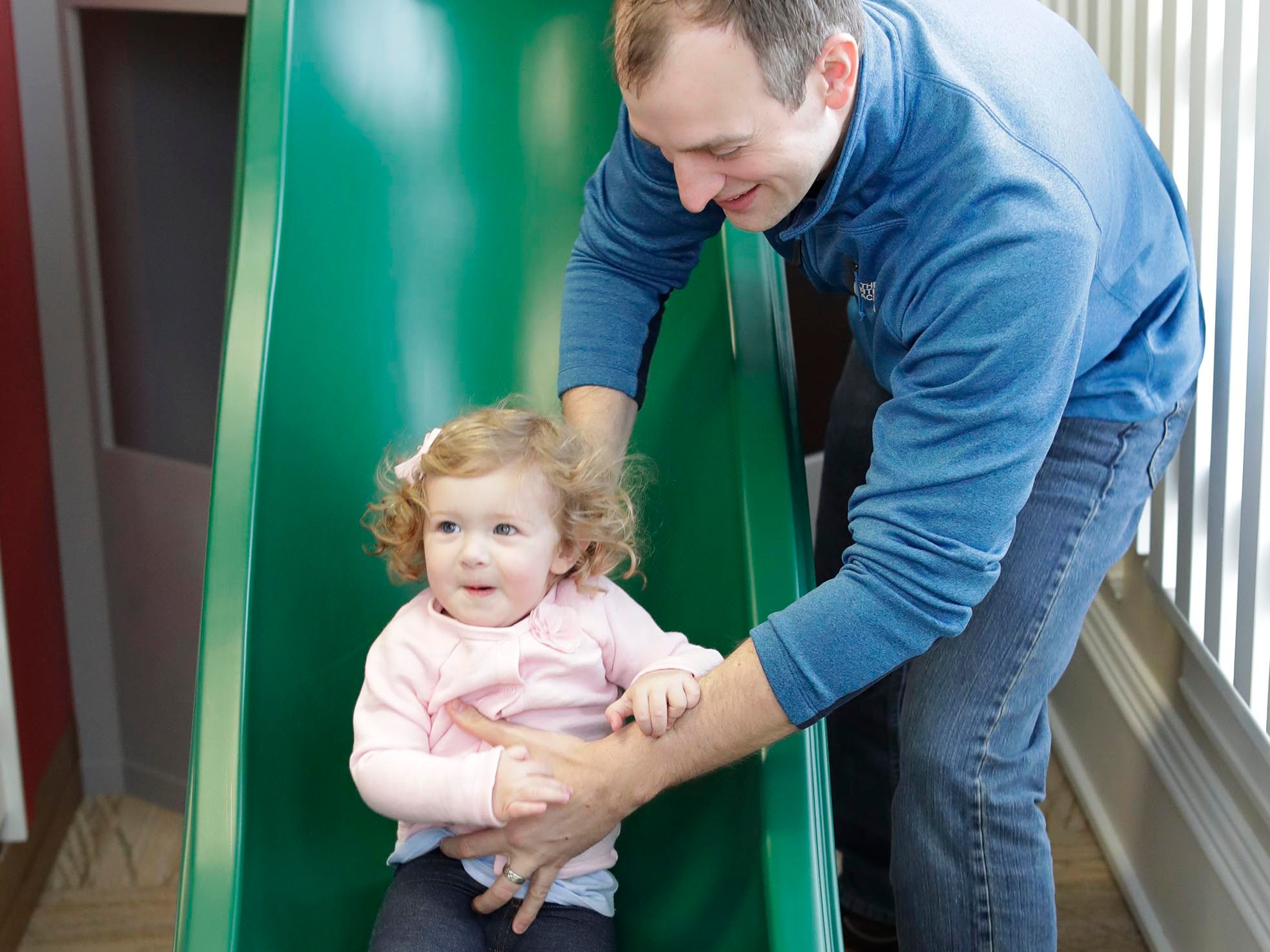 Siena Hesselink, 1, slides down a small slide with her dad Eric at her side at the Above and Beyond Children's Museum, Saturday, February 23, 2019, in Sheboygan, Wis. The Museum opened the Toddler Barnyard this weekend.