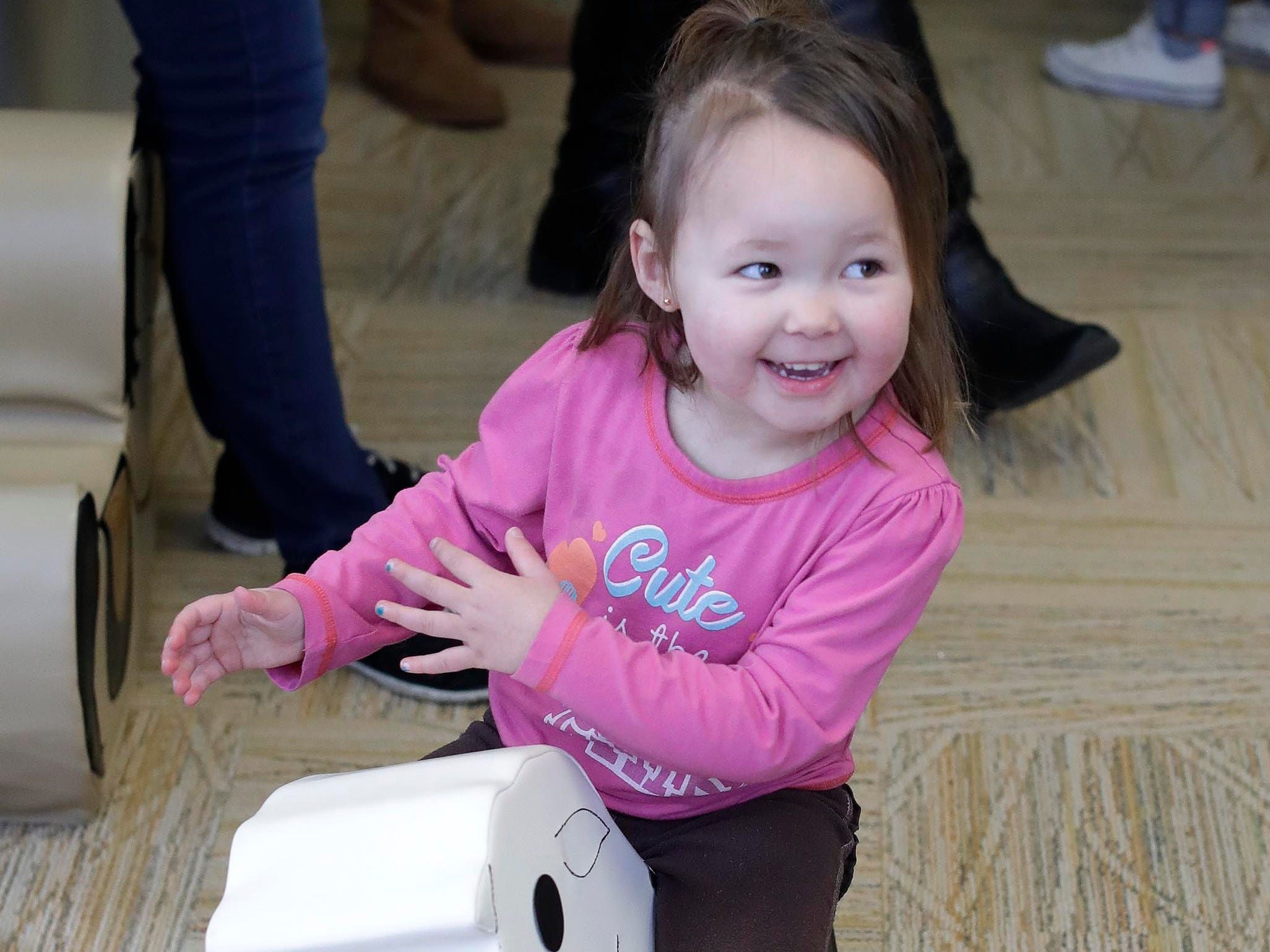 Vivian Geary, 3, of Sheboygan, is all smiles on a cow toy at the Toddler Barnyard at the Above and Beyond Children's Museum, Saturday, February 23, 2019, in Sheboygan, Wis. The new feature opened Saturday.