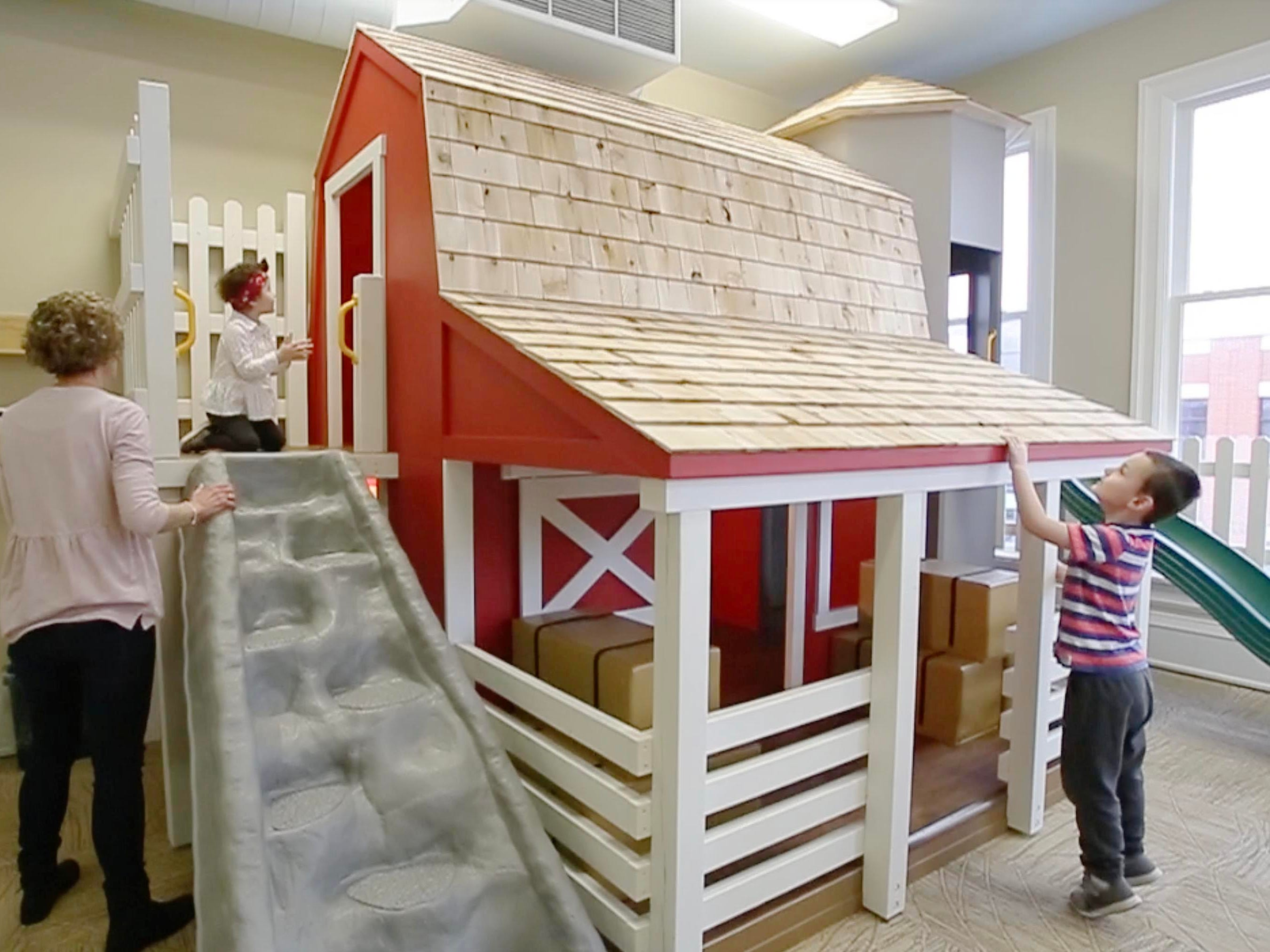 Youngsters inspect the new Toddler Barnyard at the Above and Beyond Children's Museum, Saturday, February 23, 2019, in Sheboygan, Wis.