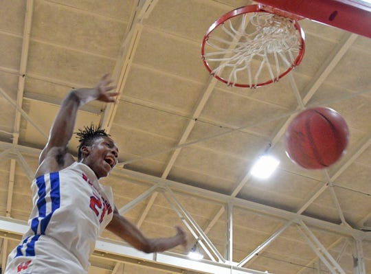 Woodlawn's Michael Jones completes one of his three dunks against BTW Friday night in the 2019 LHSAA Class 4A state playoffs.