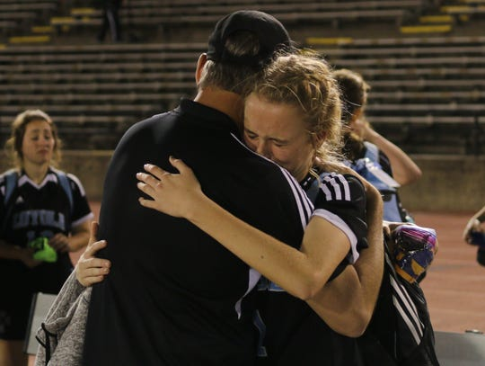 Loyola head coach Mark Matlock consoles daughter, Kalli, then a freshman, after the 2017 state championship game defeat.
