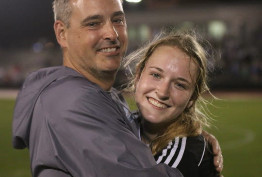 Loyola girls soccer coach Mark Matlock and daughter, Kalli, celebrate Friday's state championship victory -- the first in program history.