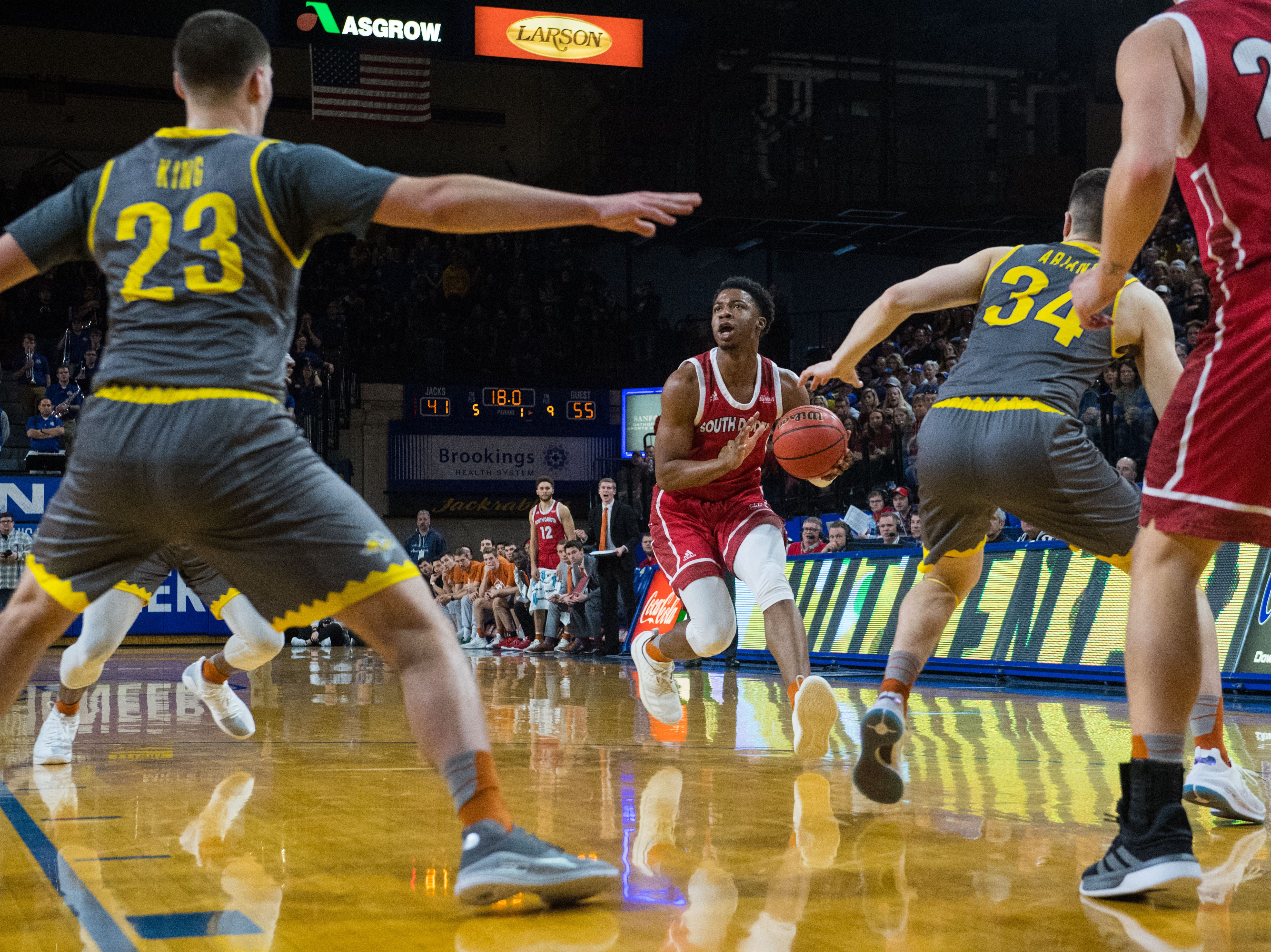 USD's Stanley Umude (0) looks to pass the ball during a game against SDSU, Saturday, Feb. 23, 2019 in Brookings, S.D.