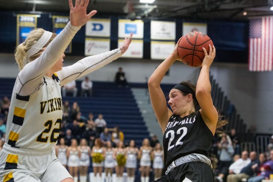 Augustana's Lynsey Prosser (22) blocks USF's Mariah Szymanski (22) during a game, Friday, Feb. 22, 2019 in Sioux Falls, S.D.