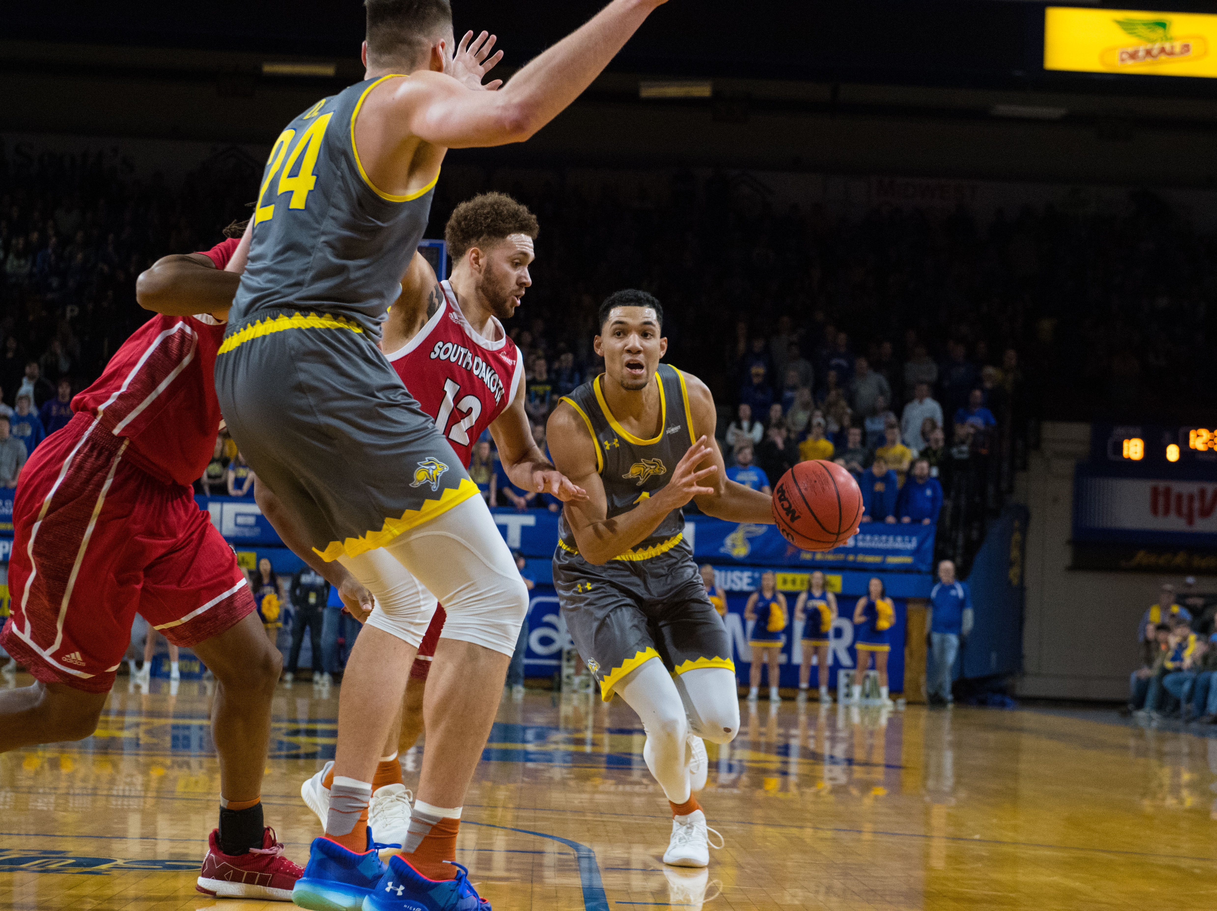 SDSU's Skyler Flatten (1) dribbles the ball past USD players during a game, Saturday, Feb. 23, 2019 in Brookings, S.D.