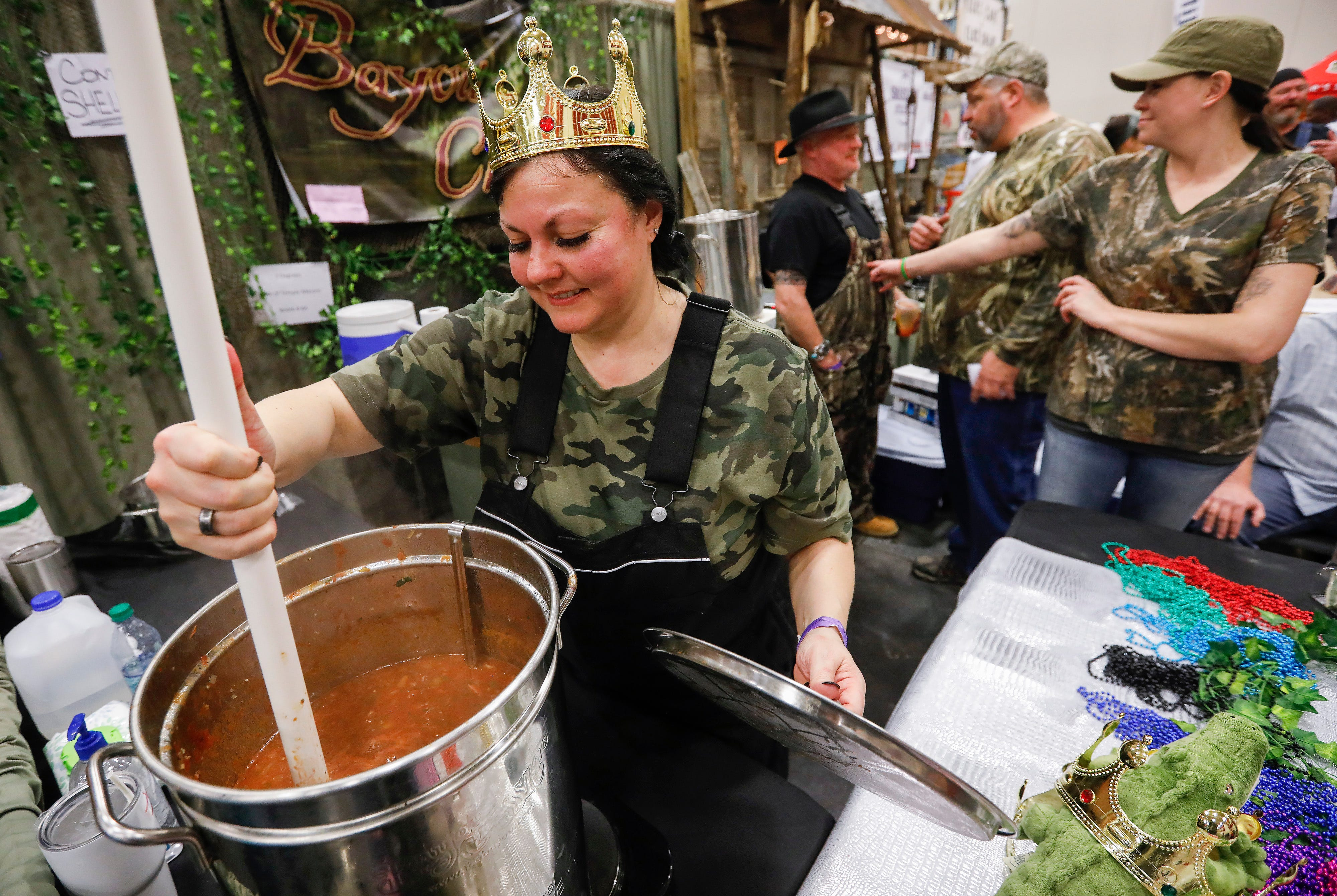 Stacia Buffington, of the Gate of the Masons Temple, stirs her team's chili during the 2019 Sertoma Chili Cook-Off at the Springfield Expo Center on Saturday, Feb. 23, 2019.