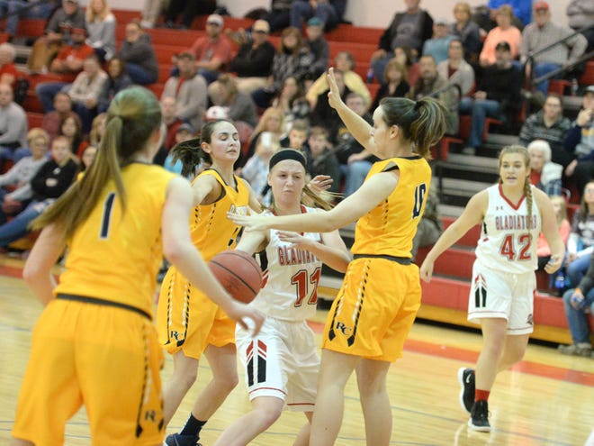 Riverheads' Sara Moore makes a pass Friday night in the Region 1B girls basketball semifinals.
