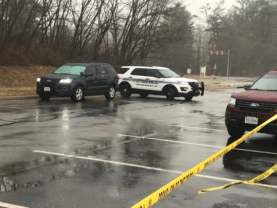 Investigators from the Waynesboro Police Department investigate Saturday afternoon after the discovery of a woman's body.