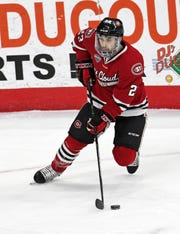 Senior forward Robby Jackson makes a move to create space in St. Cloud State's NCHC contest against Nebraska-Omaha at Baxter Arena.