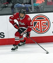 St. Cloud State sophomore Blake Lizotte carries the puck up the ice against Nebraska-Omaha in Friday's game at Baxter Arena.