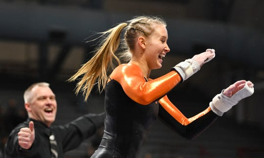 Kaija Ludewig celebrates at the end of her routine on the uneven bars during 2019 Minnesota gymnastics Class 2A team competition Friday, Feb. 22, at Maturi Pavilion in Minneapolis.