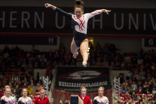 SUU's Shylen Murakami jumps in her balance beam routine during the Flippin' Birds' 196-195.400 win over the No. 17 BYU Cougars on Friday, Feb. 22, 2019.