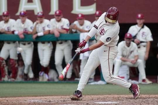 Florida State Seminoles designated hitter Robby Martin (26) swings at the pitch. The Florida State Seminoles host the Youngstown Penguins, Saturday Feb. 23, 2019.