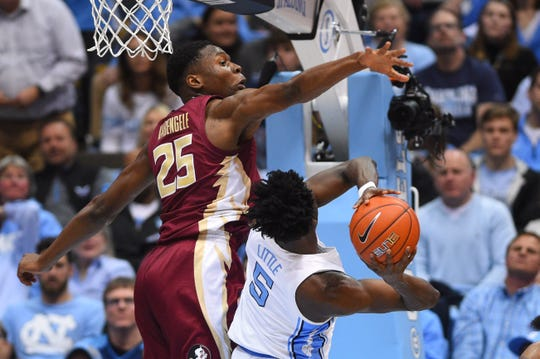 Feb 23, 2019; Chapel Hill, NC, USA; North Carolina Tar Heels forward Nassir Little (5) shoots as Florida State Seminoles forward Mfiondu Kabengele (25) defends in the first half at Dean E. Smith Center. Mandatory Credit: Bob Donnan-USA TODAY Sports