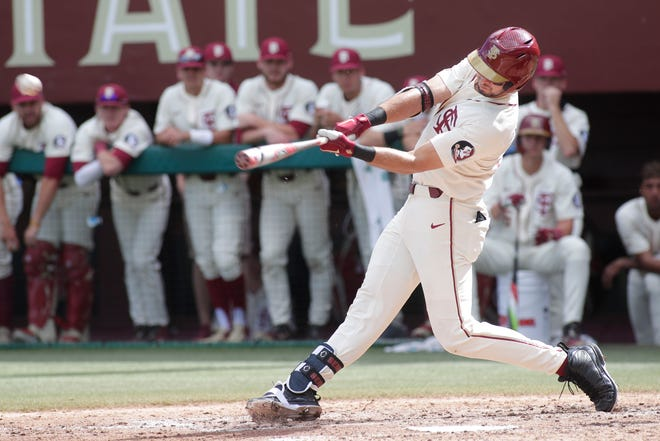 Florida State Seminoles infielder Drew Mendoza (22) makes contact with the pitch. The Florida State Seminoles host the Youngstown Penguins, Saturday Feb. 23, 2019.