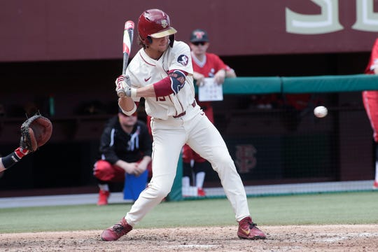 Florida State Seminoles outfielder Elijah Cabell (14) swings at the pitch. The Florida State Seminoles host the Youngstown Penguins, Saturday Feb. 23, 2019.