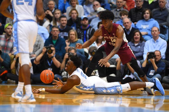Feb 23, 2019; Chapel Hill, NC, USA; North Carolina Tar Heels forward Nassir Little (5) and Florida State Seminoles guard Terance Mann (14) fight for the ball in the first half at Dean E. Smith Center. Mandatory Credit: Bob Donnan-USA TODAY Sports
