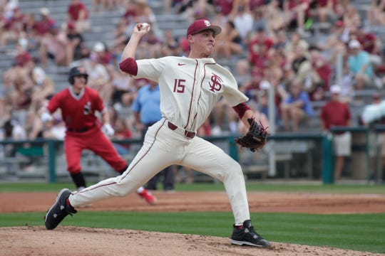 Florida State Seminoles right handed pitcher CJ Van Eyk (15) throws a pitch. The Florida State Seminoles host the Youngstown Penguins, Saturday Feb. 23, 2019.