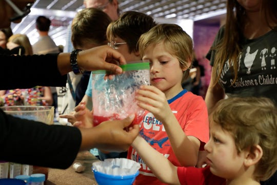 Kaiden David-Richards, 8, left, and Adrian David-Richards, 3, learn about extracting DNA from fruit. Hundreds attend the MagLab open house to learn about science, Saturday Feb. 23, 2019.