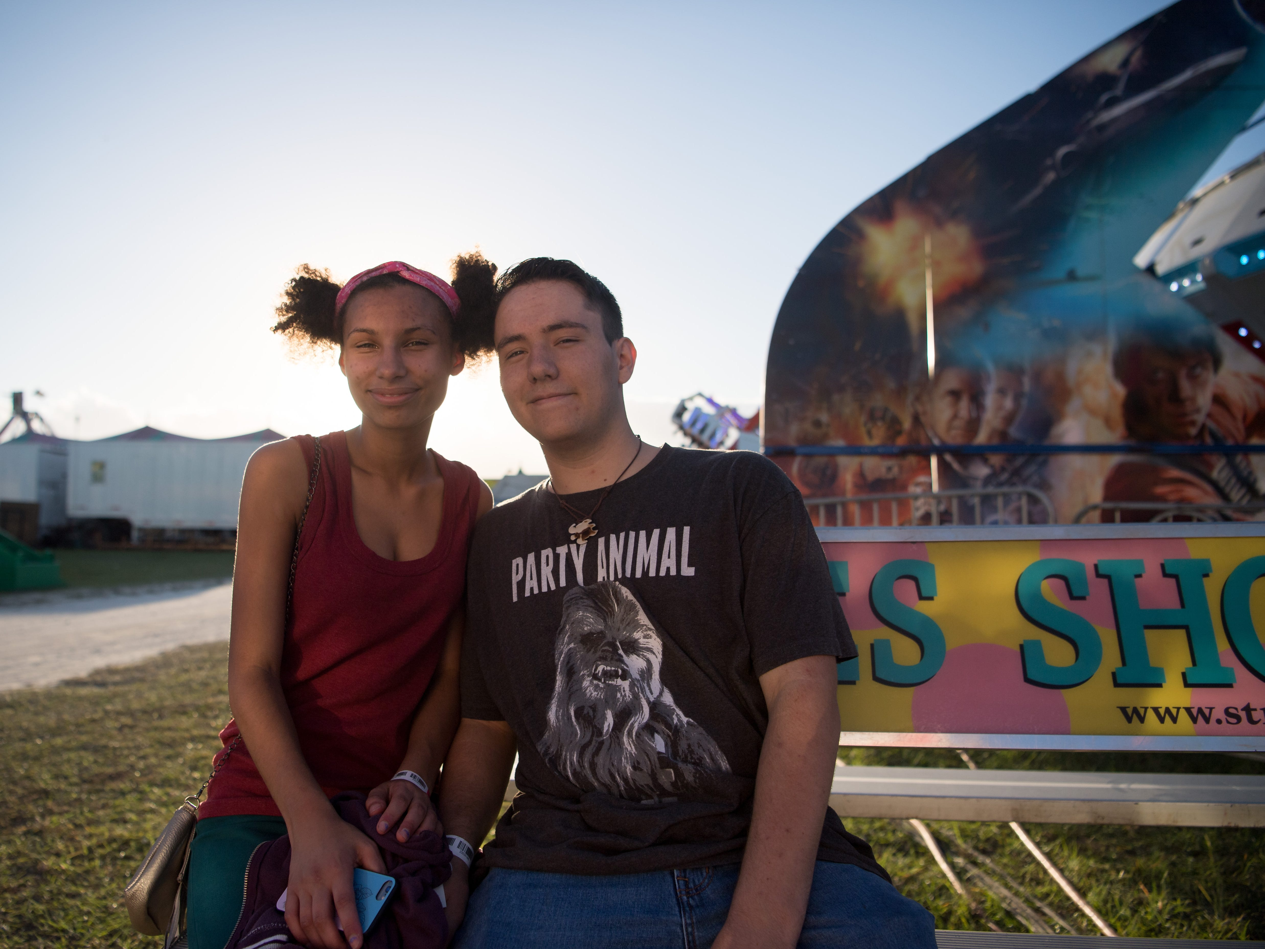 Dysani Hart (left) and Kaileb Riffel, both 17 and from Port St. Lucie, spend their first date at the St. Lucie County Fair on Friday, Feb. 22, 2019, at the St. Lucie County Fairgrounds at 15601 West Midway Road in Fort Pierce.