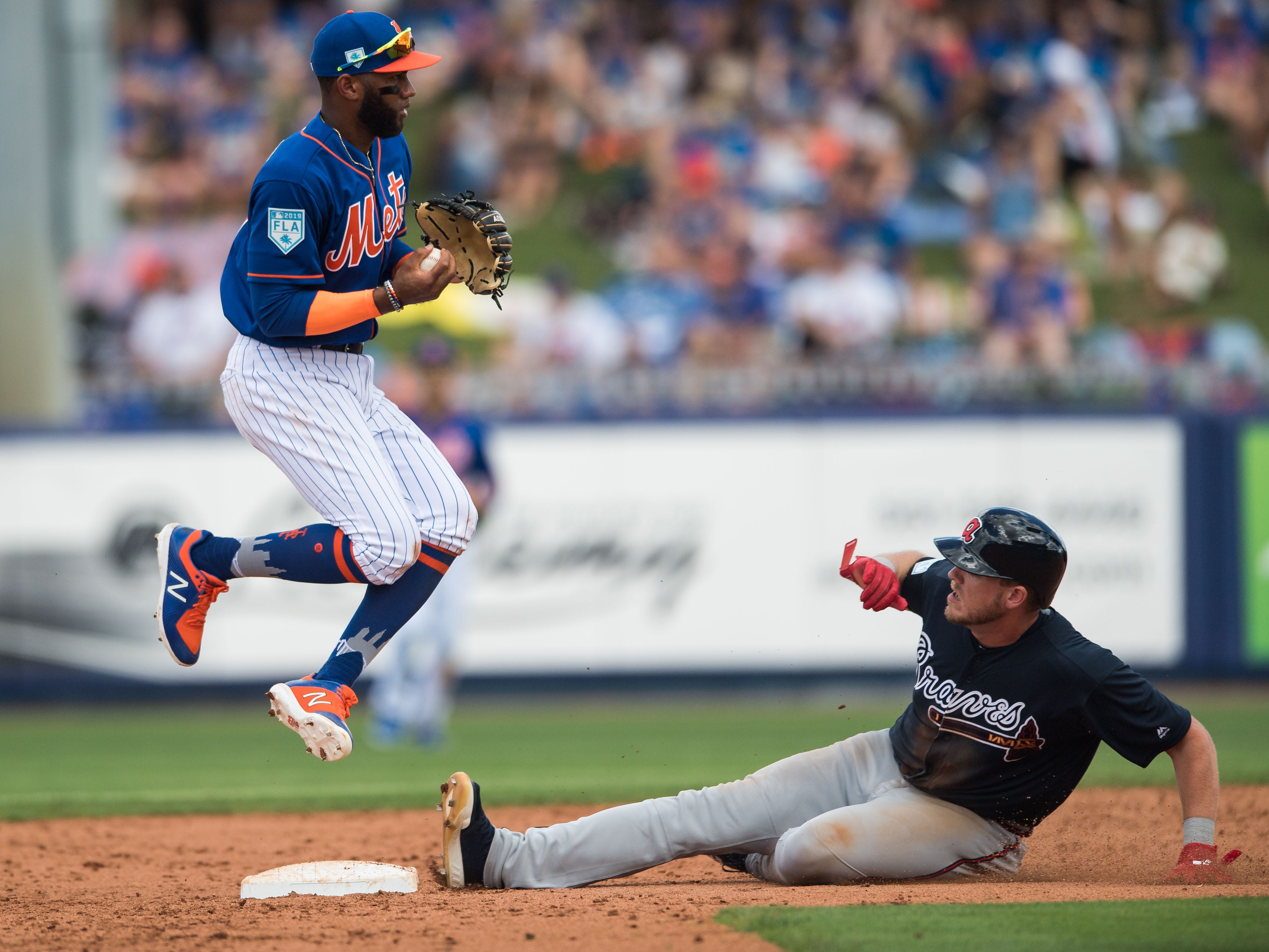 The New York Mets' Amed Roario forces Atlanta Braves baserunner Greyson Jenista out at second base during the fourth inning of their opening spring training game Saturday, Feb. 23, 2019, at First Data Field in Port St. Lucie.