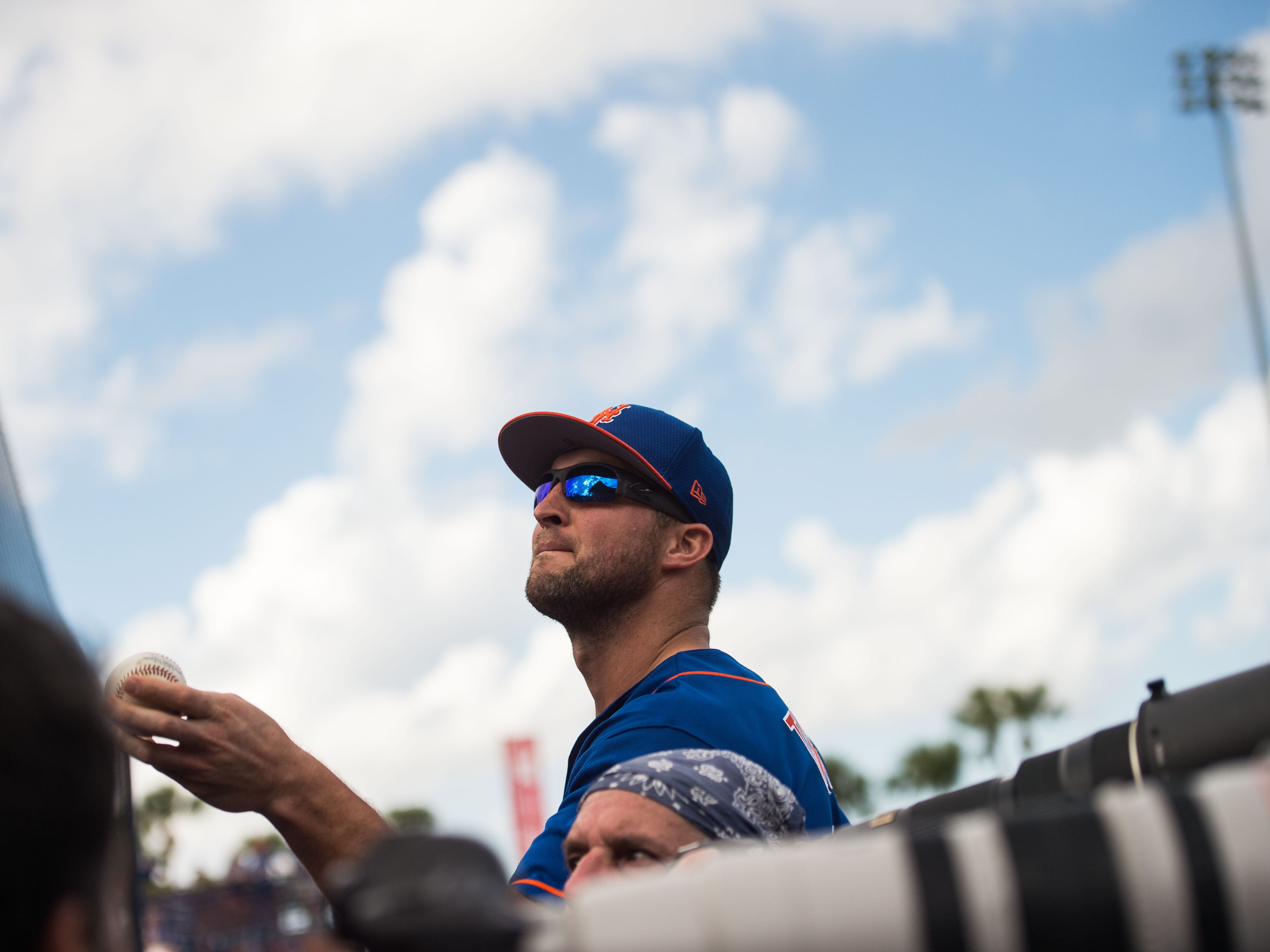 The New York Mets' Tim Tebow tosses a ball to a fan during their spring training game against the Atlanta Braves on Saturday, Feb. 23, 2019, at First Data Field in Port St. Lucie.