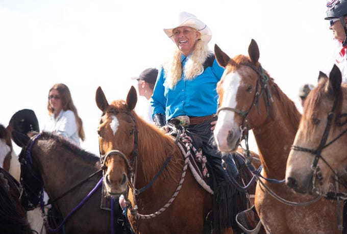 "Penny Trull, of Anglewood, and her rescued quarter horse named ""Calamity Jane,"" set up to participate in the 32nd annual Florida Cracker Trail Ride across the state parade finalizing the end of the ride Saturday, Feb. 23, 2019, in Fort Pierce. ""It has been wonderful,"" Trull said about the ride, adding, ""We are keeping history alive."""