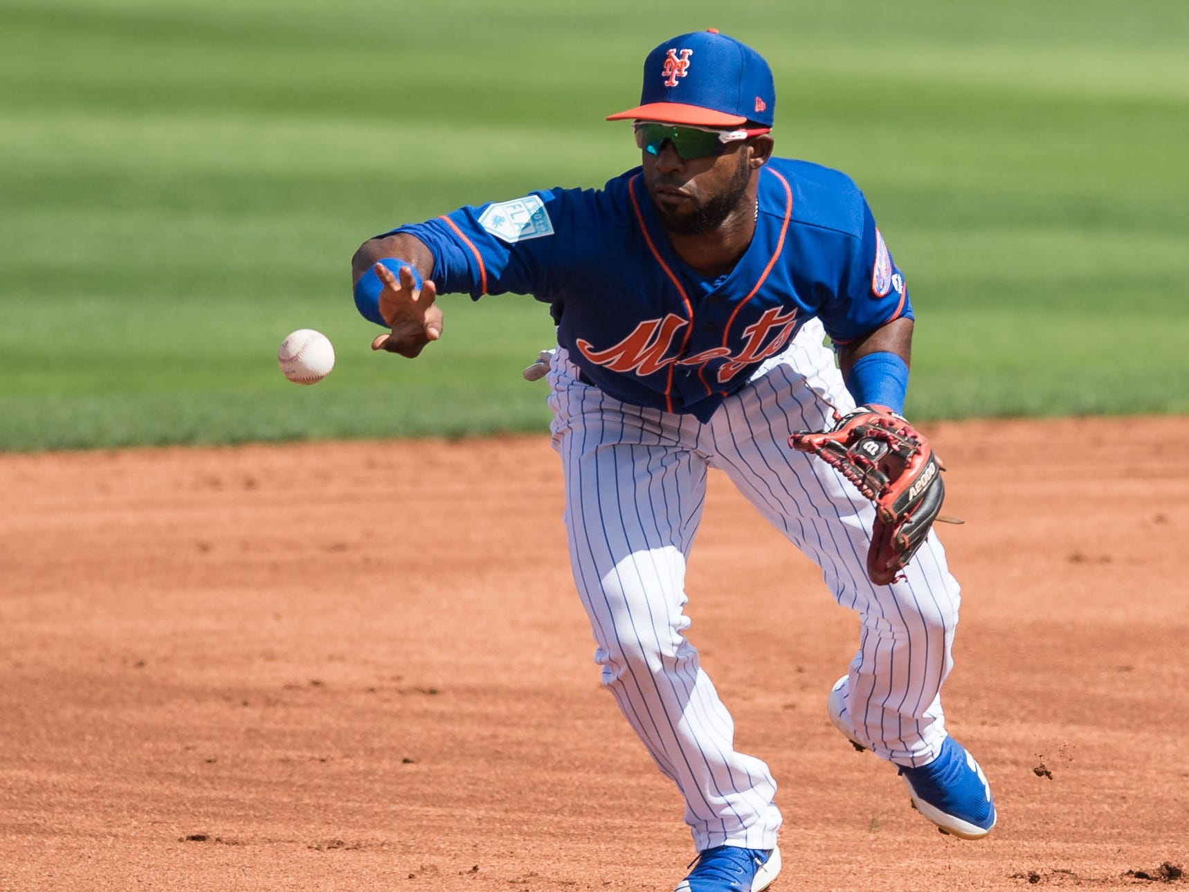 New York Mets second-baseman Arismendy Alcántara fields a grounder and tosses it to shortstop Amed Rosario to force Atlanta Braves baserunner Austin Riley out at second in the second inning during the opening spring training game Saturday, Feb. 23, 2019, at First Data Field in Port St. Lucie.