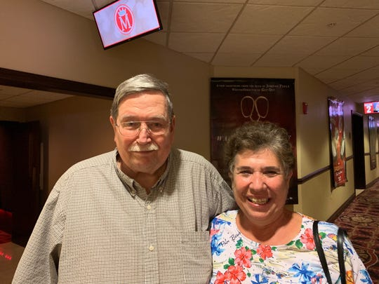 """Chuck Fletcher is a greeter at Majestic 11 in Vero Beach, and his wife, Debra, are shown Feb. 22, 2019, at the theater after watching their son's film, """"St. Agatha."""""""