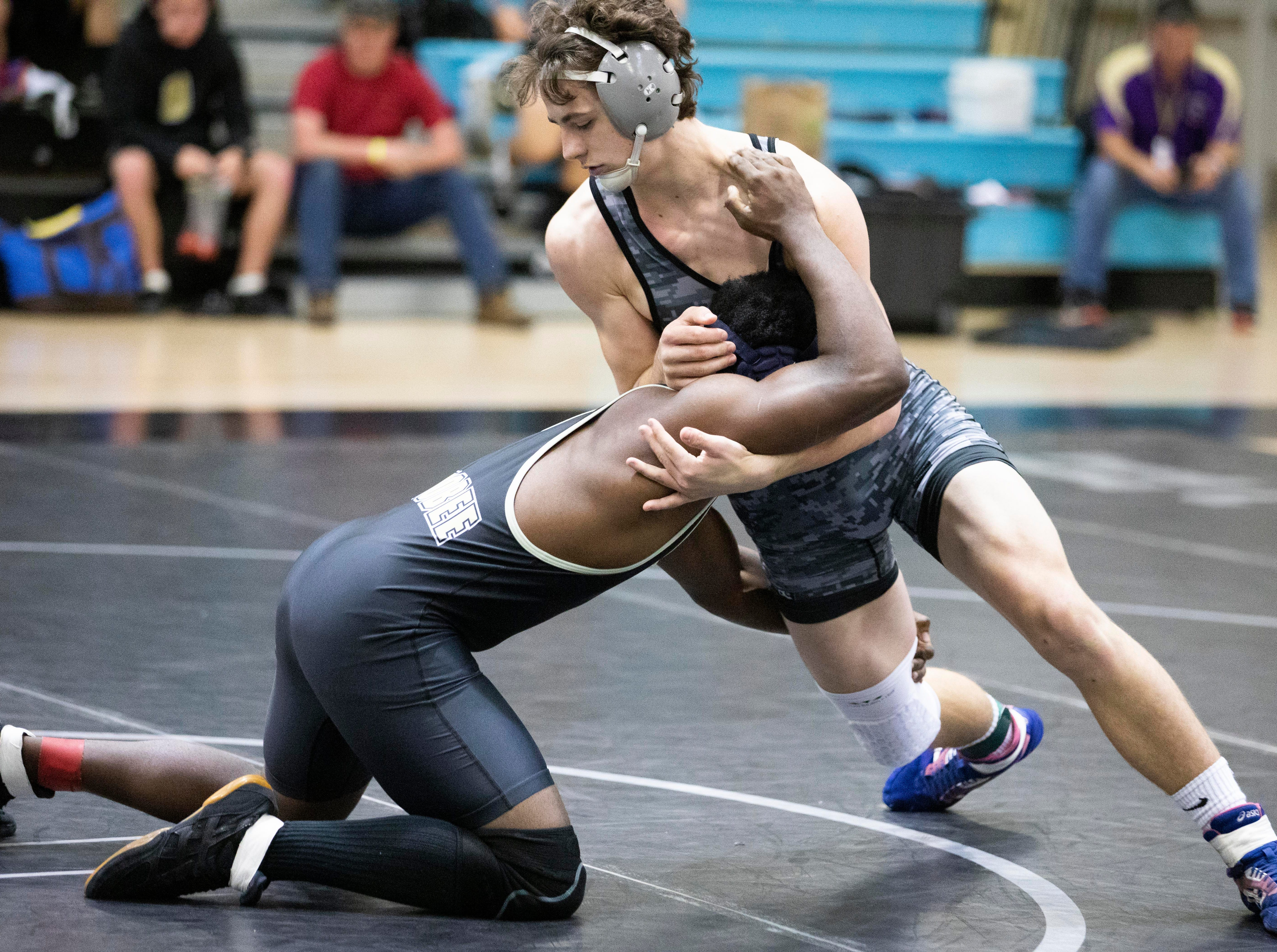 Jensen Beach's Andrew Burnette (top) wrestles against Isaac Herron of Okeechobee during the District 14-2A wrestling tournament on Friday, Feb. 22, 2019, in Jensen Beach. Burnette won his match with a fall at 3:21, and Jensen Beach won the tournament with 249.5 points. Okeechobee finished second with 153.5 points.