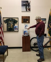 National Border Patrol Museum director David Ham shows some of the damage done to displays in the room that serves as a memorial to agents who have died in the line of duty.