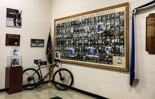 Photos of Border Patrol agents who have died in the line of duty were covered with stickers bearing the faces of children who died in Border Patrol custody. The children were already ill before they were taken into custody.