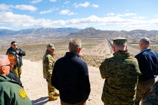 Acting Secretary of Defense Patrick Shanahan, center, and Joint Chiefs Chairman Gen. Joseph Dunford, second from the right, look across the horizon during a tour of the U.S.-Mexico border at Santa Teresa Station in Sunland Park, N.M., on Saturday, Feb. 23, 2019. Top defense officials toured sections of the U.S.-Mexico border Saturday to see how the military could reinforce efforts to block drug smuggling and other illegal activity, as the Pentagon weighs diverting billions of dollars for President Donald Trump's border wall.