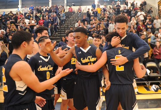 Santa Clara High players celebrate after winning the CIF-SS Division 5AA title Saturday.