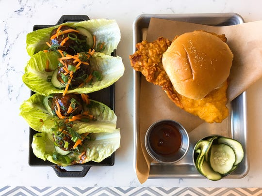 Dishes at the opening-soon Social Monk Asian Kitchen include chicken meatballs, left, and a fried chicken sandwich with pickles and sriracha-honey sauce.