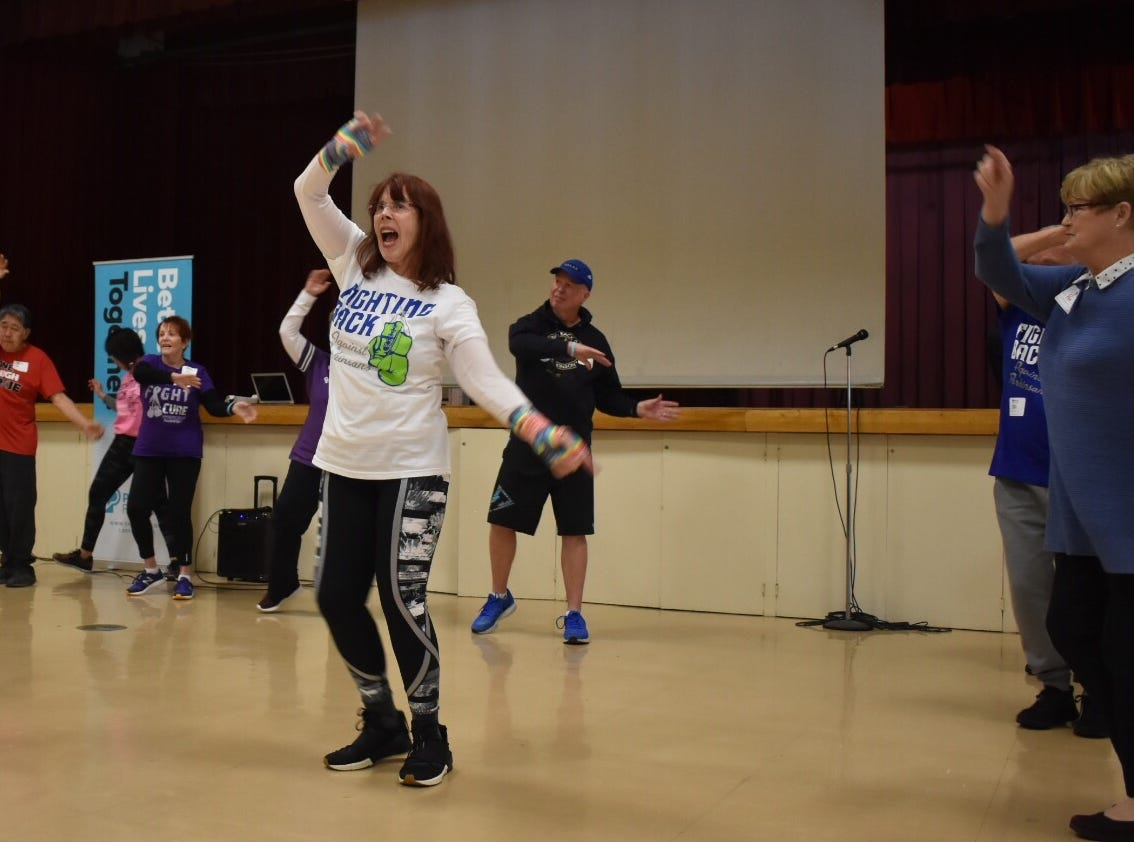 Yvette Israel, center, teaches boxing to people with Parkinson's at a conference put together by the Parkinson's Foundation.