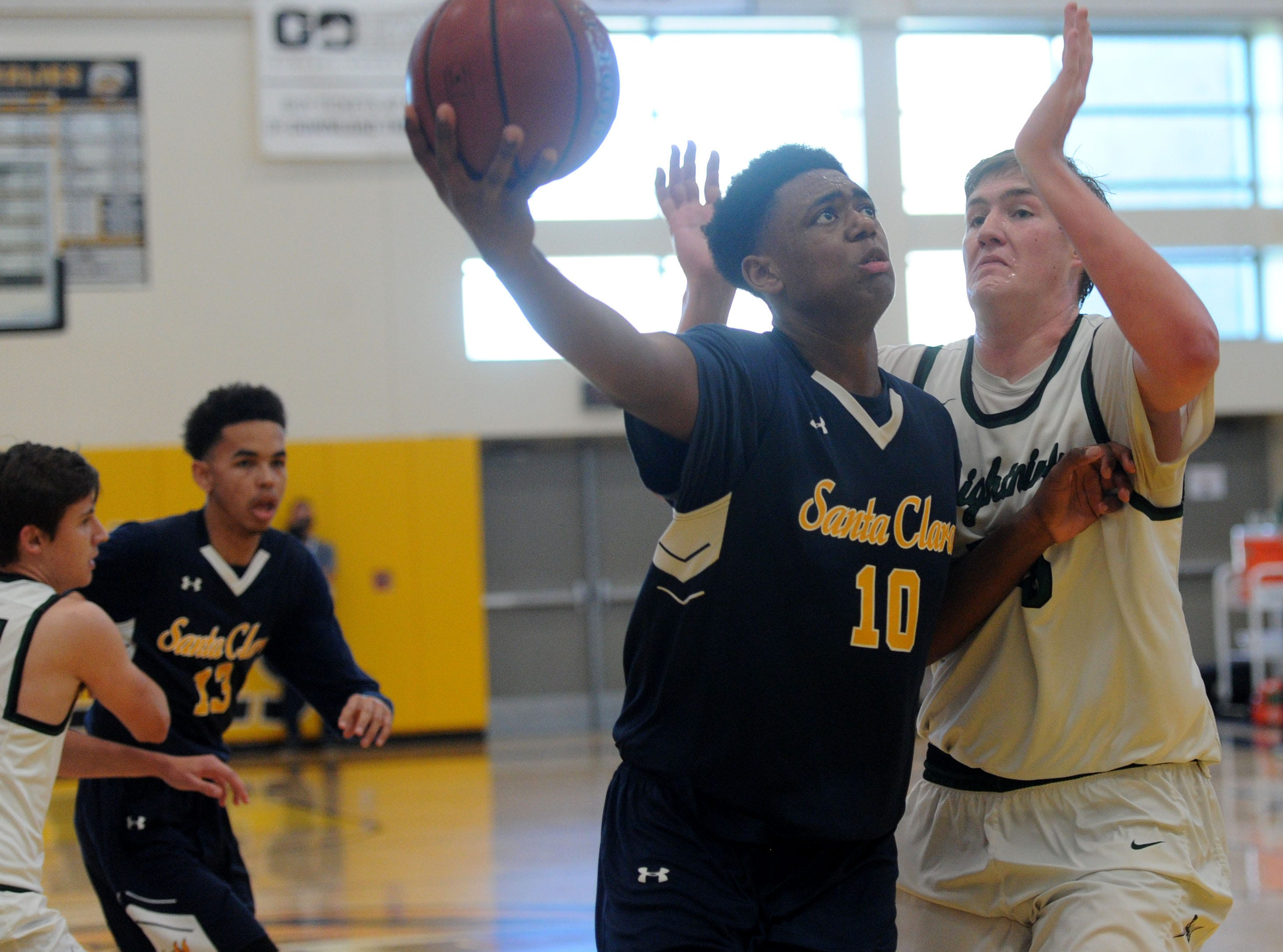 Santa Clara High's Christian Oliver slips past Johnny King of Sage Hill during the CIF-SS Division 5AA boys basketball final Saturday at Godinez High in Santa Ana. The Saints won 68-52.