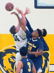 Santa Clara High's Christian Oliver (10) blocks a shot attempt by Sage Hill's Johnny King during the CIF-SS Division 5AA boys basketball final Saturday at Godinez High in Santa Ana. The Saints won 68-52.
